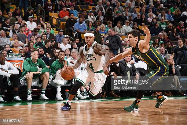 Isaiah Thomas of the Boston Celtics handles the ball against Raul Neto of the Utah Jazz on February 29 2016 at the TD Garden in Boston Massachusetts...