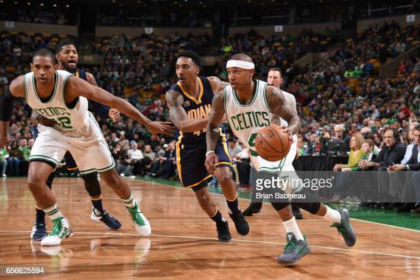 Isaiah Thomas of the Boston Celtics handles the ball against the Indiana Pacers during the game on March 22 2017 at the TD Garden in Boston...