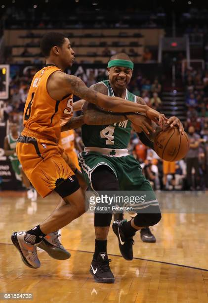 Isaiah Thomas of the Boston Celtics handles the ball against Tyler Ulis of the Phoenix Suns during the NBA game at Talking Stick Resort Arena on...