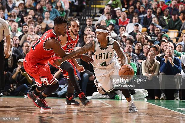 Isaiah Thomas of the Boston Celtics handles the ball during the game against the Chicago Bulls on December 9 2015 at the TD Garden in Boston...