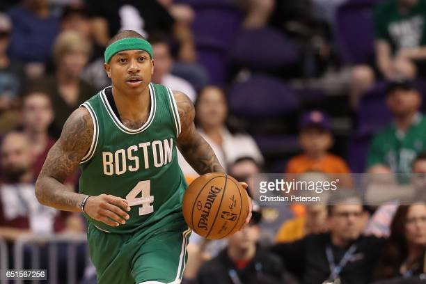 Isaiah Thomas of the Boston Celtics handles the ball during the NBA game against the Phoenix Suns at Talking Stick Resort Arena on March 5 2017 in...