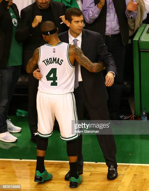 Isaiah Thomas of the Boston Celtics hugs Brad Stevens against the Washington Wizards during Game Seven of the NBA Eastern Conference SemiFinals at TD...