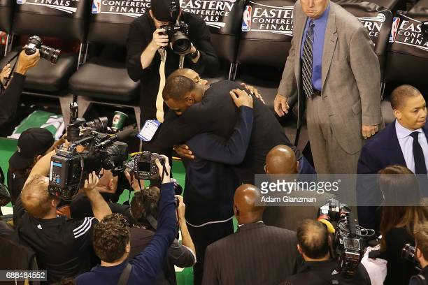Isaiah Thomas of the Boston Celtics hugs LeBron James of the Cleveland Cavaliers after the Cavaliers defeated the Celtics 135102 in Game Five of the...