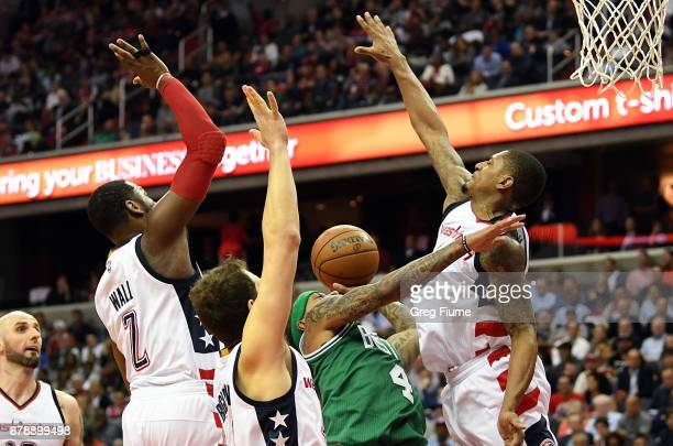 Isaiah Thomas of the Boston Celtics is defended by John Wall Bojan Bogdanovic and Bradley Beal of the Washington Wizards during the third quarter...
