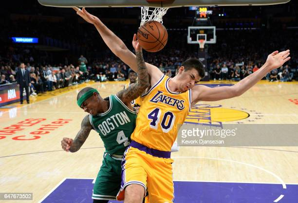 Isaiah Thomas of the Boston Celtics is fouled by Ivica Zubac of the Los Angeles Lakers during the first half of the basketball game at Staples Center...