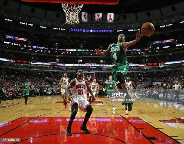 Isaiah Thomas of the Boston Celtics misses a pass in front of Jimmy Butler of the Chicago Bulls during Game Four of the Eastern Conference...