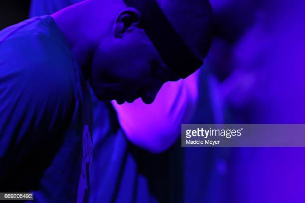 Isaiah Thomas of the Boston Celtics observes a moment of silence dedicated to his sister Chyna Thomas who was killed in a car accident on April 15...