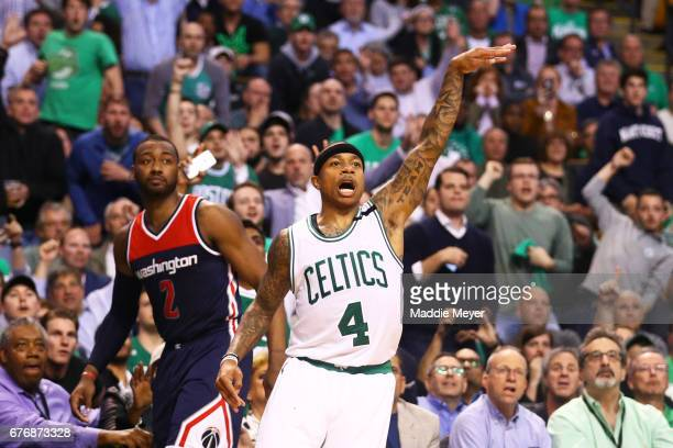 Isaiah Thomas of the Boston Celtics reacts after hitting a three point shot against the Washington Wizards during the fourth quarter of Game Two of...
