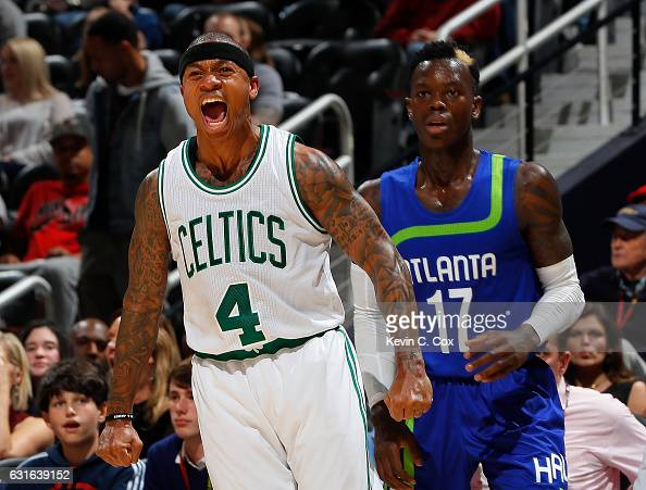 Isaiah Thomas of the Boston Celtics reacts after hitting a threepoint basket against the Dennis Schroder of the Atlanta Hawks at Philips Arena on...