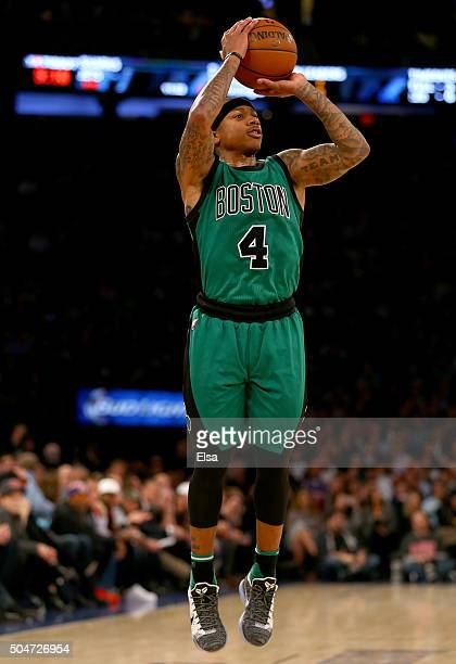 Isaiah Thomas of the Boston Celtics shoots a three point shot in the second half against the New York Knicks at Madison Square Garden on January 12...