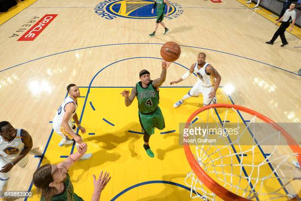 Isaiah Thomas of the Boston Celtics shoots the ball during the game against the Golden State Warriors on March 8 2017 at ORACLE Arena in Oakland...