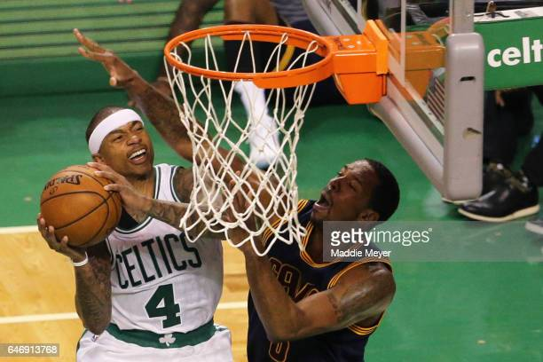 Isaiah Thomas of the Boston Celtics takes a shot against Channing Frye of the Cleveland Cavaliers during the third quarter at TD Garden on March 1...