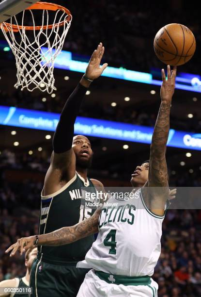 Isaiah Thomas of the Boston Celtics takes a shot against Greg Monroe of the Milwaukee Bucks during the third quarter at TD Garden on March 29 2017 in...