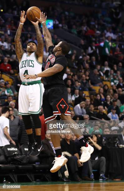 Isaiah Thomas of the Boston Celtics takes a shot against Isaiah Canaan of the Chicago Bulls during the third quarter of Game Five of the Eastern...