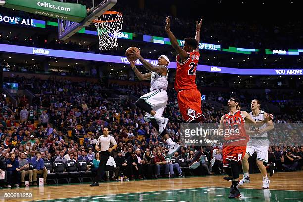 Isaiah Thomas of the Boston Celtics takes a shot over Jimmy Butler of the Chicago Bulls during the first quarter at TD Garden on December 9 2015 in...