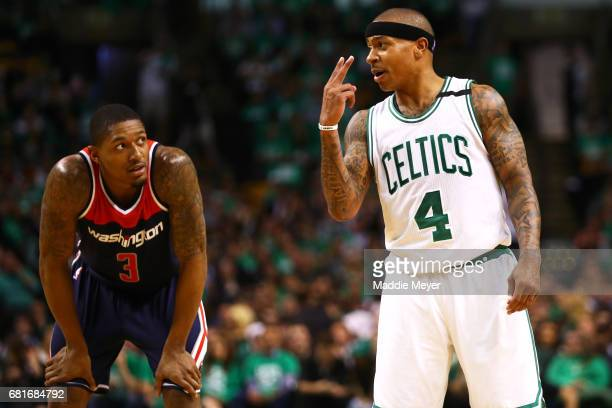 Isaiah Thomas of the Boston Celtics talks with Bradley Beal of the Washington Wizards during the second quarter of Game Five of the Eastern...