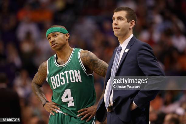 Isaiah Thomas of the Boston Celtics talks with head coach Brad Stevens during the second half of the NBA game against the Phoenix Suns at Talking...