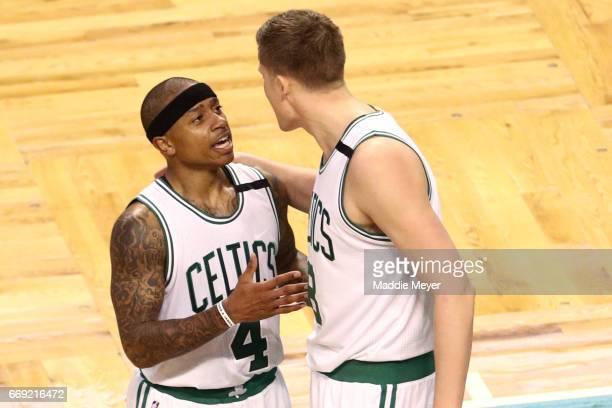 Isaiah Thomas of the Boston Celtics talks with Jonas Jerebko during the third quarter of Game One of the Eastern Conference Quarterfinals against the...
