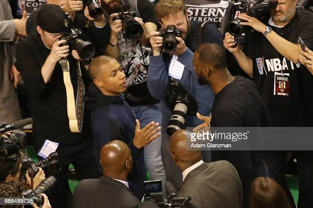 Isaiah Thomas of the Boston Celtics talks with LeBron James of the Cleveland Cavaliers after the Cavaliers defeated the Celtics 135102 in Game Five...