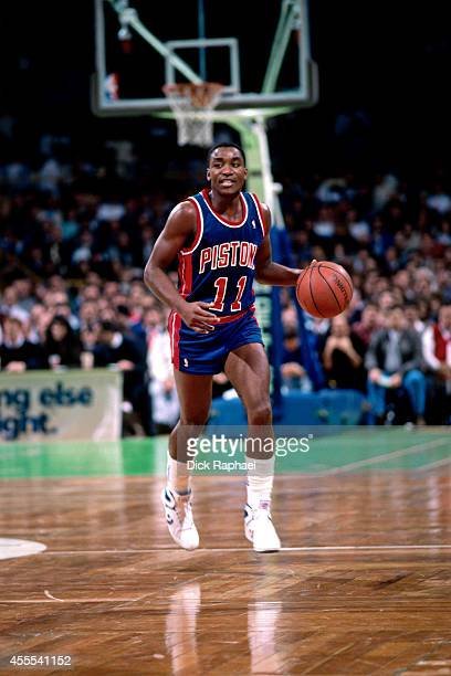 Isaiah Thomas of the Detroit Pistons dribbles the ball against the Boston Celtics during a game circa 1988 at the Boston Garden in Boston...