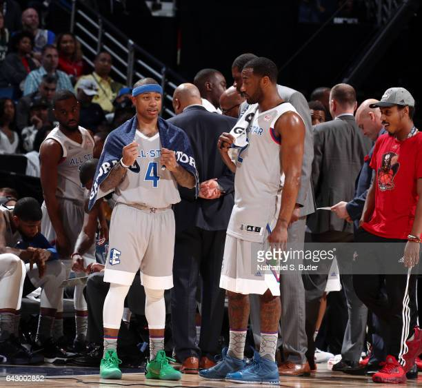 Isaiah Thomas of the Eastern Conference AllStars and John Wall of the Eastern Conference AllStars talk during the NBA AllStar Game as part of the...