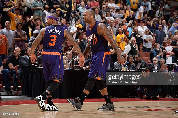 Isaiah Thomas of the Phoenix Suns and PJ Tucker of the Phoenix Suns celebrate during a game against the Los Angeles Lakers on October 21 2014 at the...