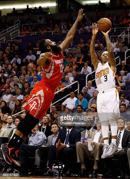 Isaiah Thomas of the Phoenix Suns puts up a three point shot against James Harden of the Houston Rockets during the second half of the NBA game at US...