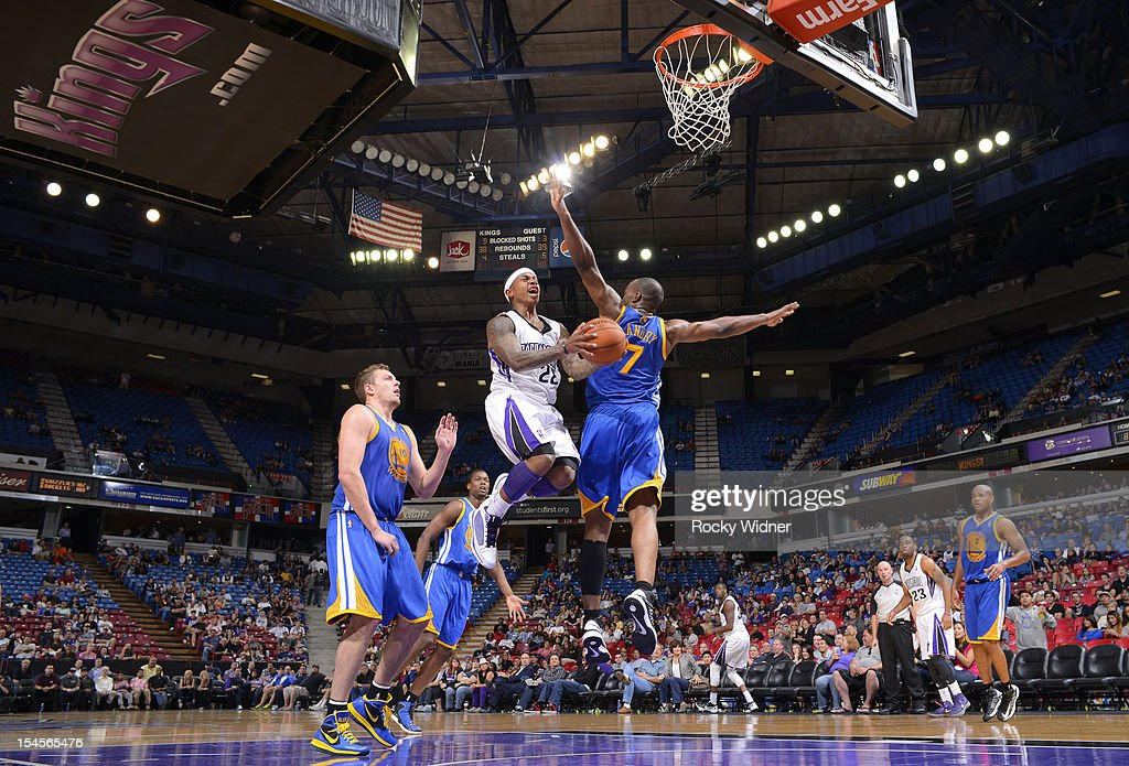 Isaiah Thomas #22 of the Sacramento Kings attempts to get off a shot against Carl Landry #7 of the Golden State Warriors on October 17, 2012 at Power Balance Pavilion in Sacramento, California.
