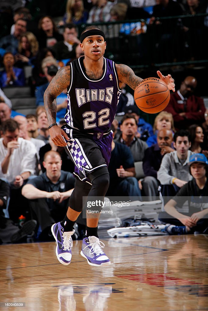 Isaiah Thomas #22 of the Sacramento Kings brings the ball up court against the Dallas Mavericks on February 13, 2013 at the American Airlines Center in Dallas, Texas.