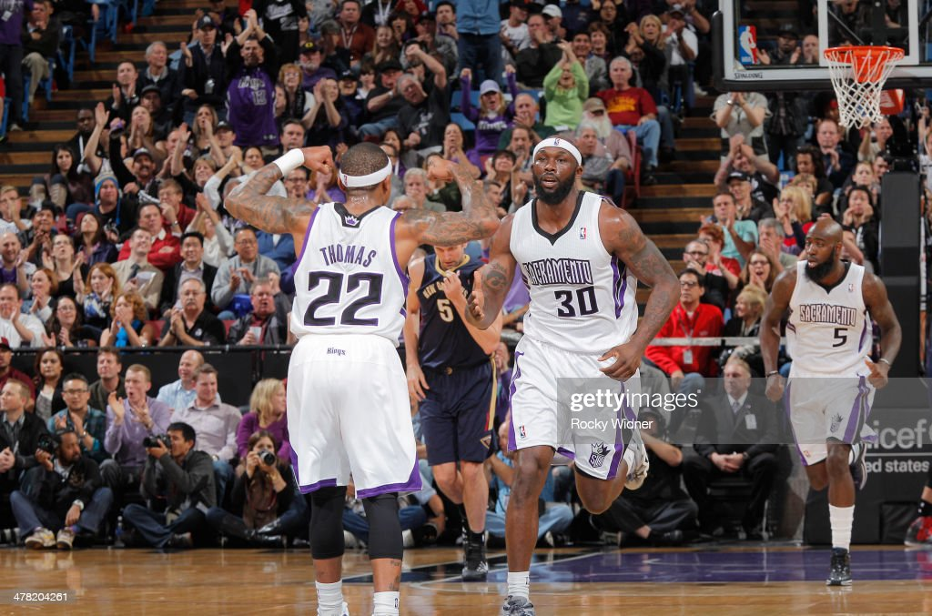 Isaiah Thomas #22 of the Sacramento Kings celebrates with teammate Reggie Evans #30 during the game against the New Orleans Pelicans on March 3, 2014 at Sleep Train Arena in Sacramento, California.