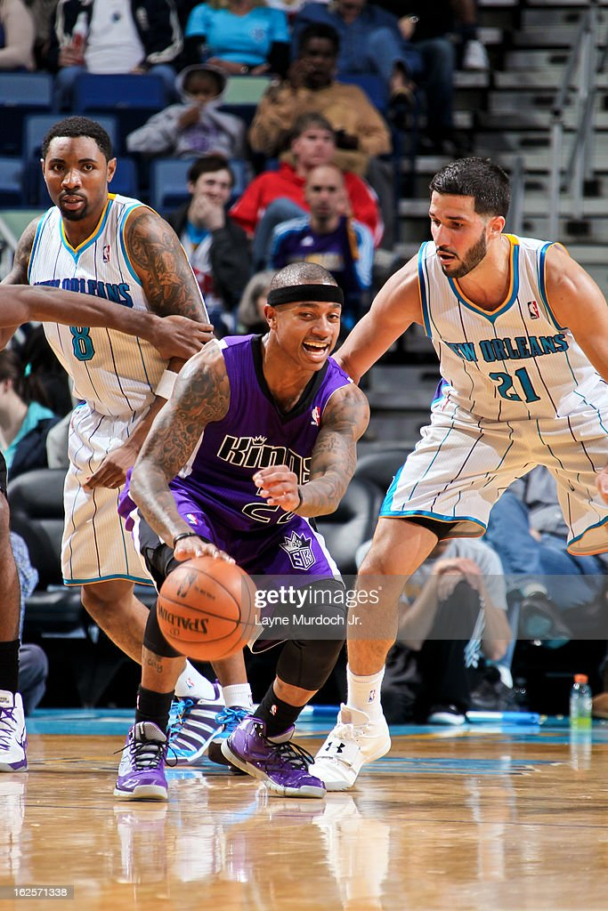 Isaiah Thomas #22 of the Sacramento Kings controls the ball against Greivis Vasquez #21 of the New Orleans Hornets on February 24, 2013 at the New Orleans Arena in New Orleans, Louisiana.