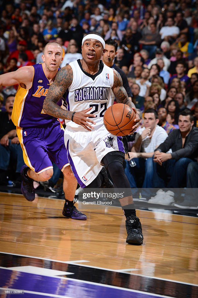 Isaiah Thomas #22 of the Sacramento Kings dribbles the ball around <a gi-track='captionPersonalityLinkClicked' href=/galleries/search?phrase=Steve+Blake&family=editorial&specificpeople=204474 ng-click='$event.stopPropagation()'>Steve Blake</a> #5 of the Los Angeles Lakers on March 30, 2013 at Sleep Train Arena in Sacramento, California.