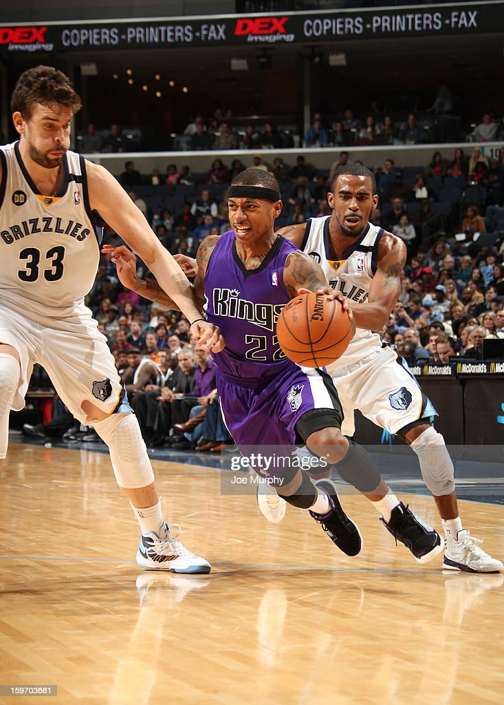 Isaiah Thomas #22 of the Sacramento Kings drives against <a gi-track='captionPersonalityLinkClicked' href=/galleries/search?phrase=Marc+Gasol&family=editorial&specificpeople=661205 ng-click='$event.stopPropagation()'>Marc Gasol</a> #33 and Mike Conley #11 of the Memphis Grizzlies on January 18, 2013 at FedExForum in Memphis, Tennessee.