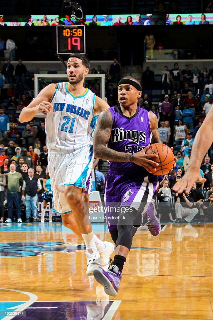 Isaiah Thomas #22 of the Sacramento Kings drives ahead of Greivis Vasquez #21 of the New Orleans Hornets on February 24, 2013 at the New Orleans Arena in New Orleans, Louisiana.