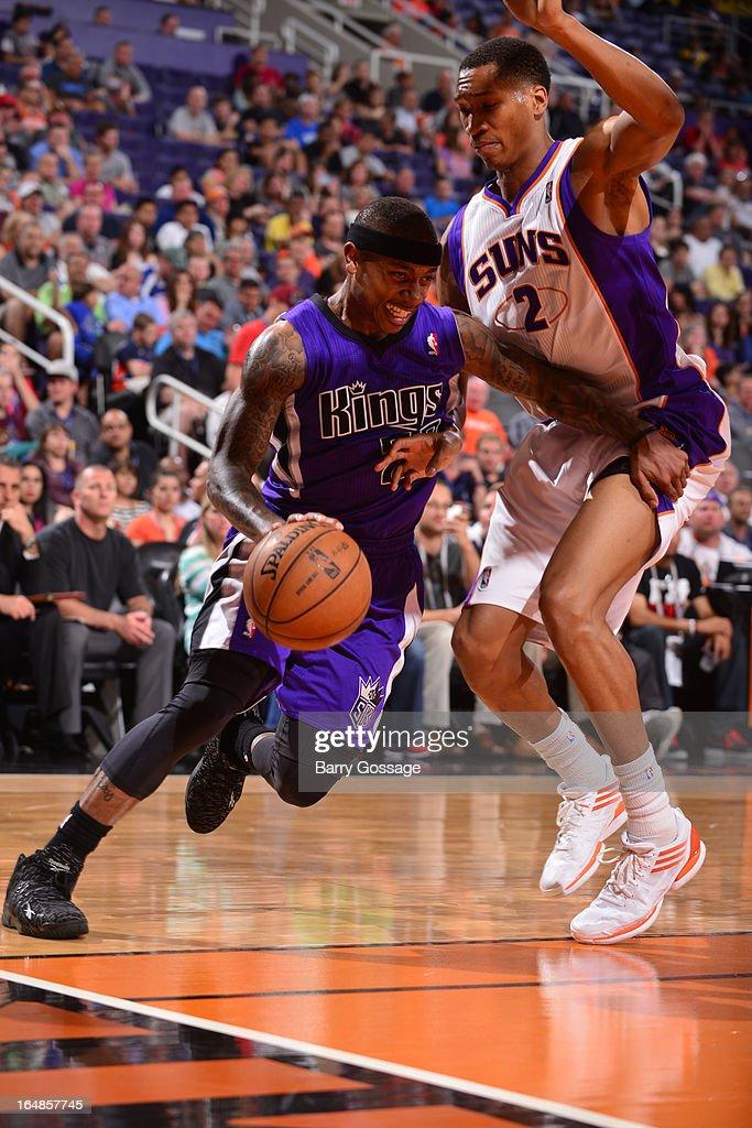 Isaiah Thomas #22 of the Sacramento Kings drives around Wesley Johnson #2 of the Phoenix Suns on March 28, 2013 at U.S. Airways Center in Phoenix, Arizona.