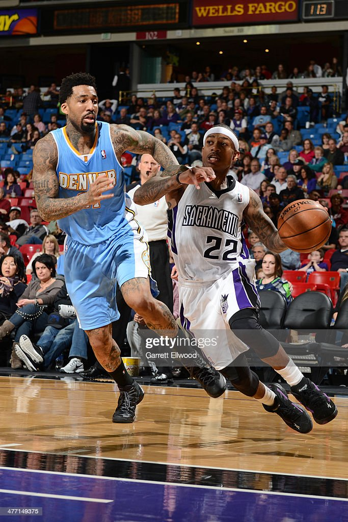 Isaiah Thomas #22 of the Sacramento Kings drives baseline against the Denver Nuggets at Sleep Train Arena on January 26, 2014 in Sacramento, California.