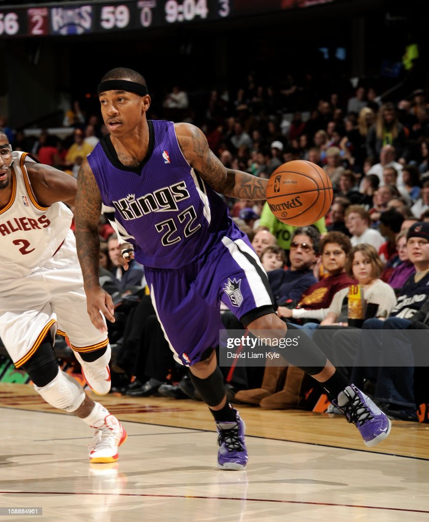 Isaiah Thomas #22 of the Sacramento Kings drives to the basket against <a gi-track='captionPersonalityLinkClicked' href=/galleries/search?phrase=Kyrie+Irving&family=editorial&specificpeople=6893971 ng-click='$event.stopPropagation()'>Kyrie Irving</a> #2 of the Cleveland Cavaliers at The Quicken Loans Arena on January 2, 2013 in Cleveland, Ohio.