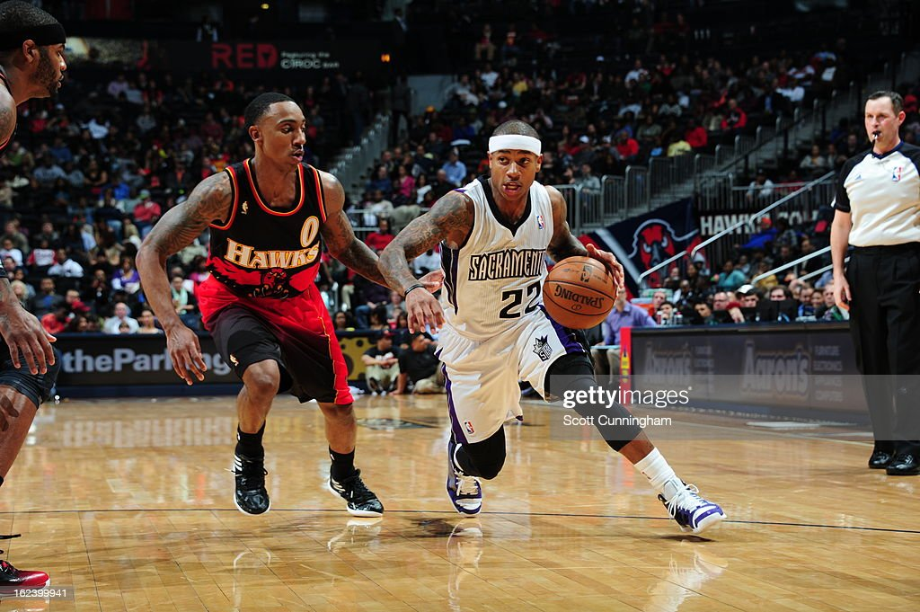 Isaiah Thomas #22 of the Sacramento Kings drives to the basket against Jeff Teague #0 of the Atlanta Hawks on February 22, 2013 at Philips Arena in Atlanta, Georgia.
