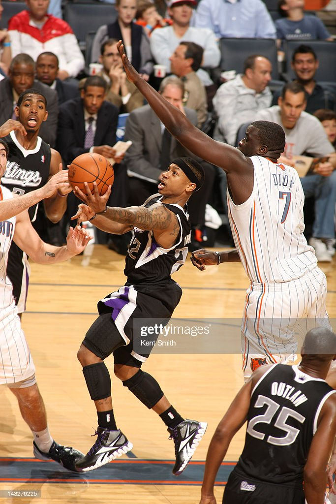 Isaiah Thomas #22 of the Sacramento Kings goes to the basket against Byron Mullens #22 and <a gi-track='captionPersonalityLinkClicked' href=/galleries/search?phrase=DeSagana+Diop&family=editorial&specificpeople=213233 ng-click='$event.stopPropagation()'>DeSagana Diop</a> #7 of the Charlotte Bobcats at the Time Warner Cable Arena on April 22, 2012 in Charlotte, North Carolina.
