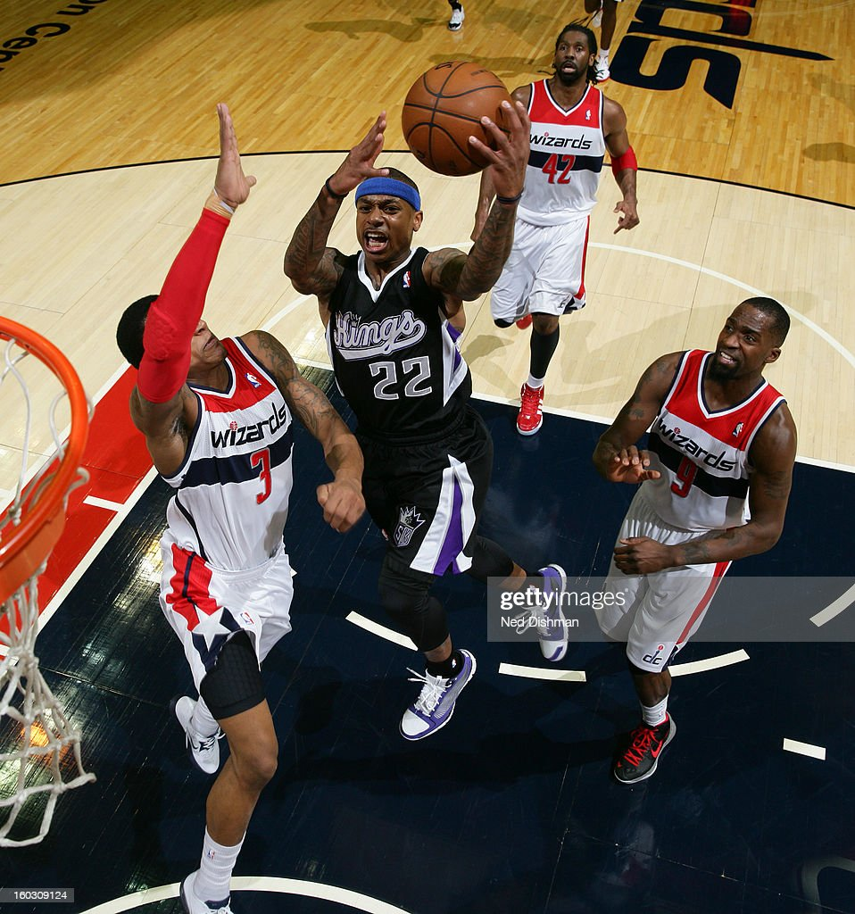 Isaiah Thomas #22 of the Sacramento Kings goes to the basket against Bradley Beal #3 and Martell Webster #9 of the Washington Wizards during the game at the Verizon Center on January 28, 2013 in Washington, DC.