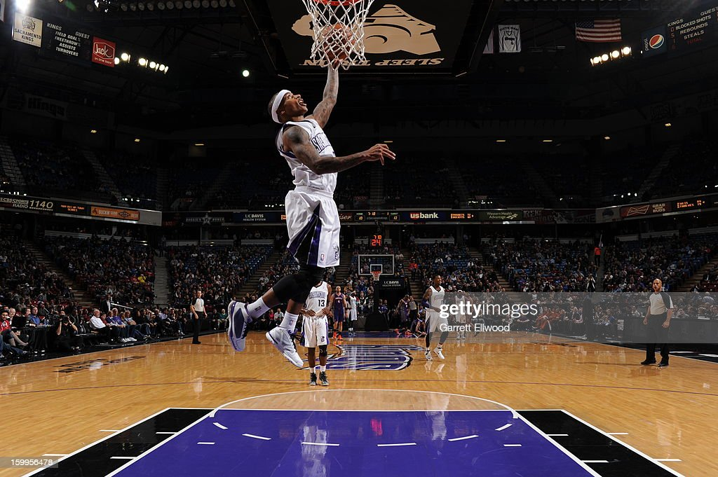 Isaiah Thomas #22 of the Sacramento Kings goes to the basket against the Phoenix Suns on January 23, 2013 at Sleep Train Arena in Sacramento, California.