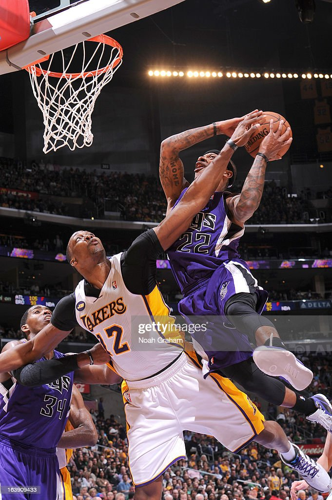 Isaiah Thomas #22 of the Sacramento Kings has his shot attempt challenged by <a gi-track='captionPersonalityLinkClicked' href=/galleries/search?phrase=Dwight+Howard&family=editorial&specificpeople=201570 ng-click='$event.stopPropagation()'>Dwight Howard</a> #12 of the Los Angeles Lakers at Staples Center on March 17, 2013 in Los Angeles, California.