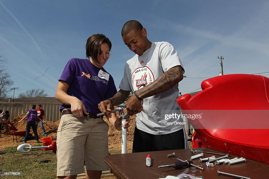 Isaiah Thomas #22 of the Sacramento Kings helps put together a playset at the 2013 NBA Cares Day of Service at the Playground Build with KaBOOM! on February 15, 2013 in Houston, Texas.