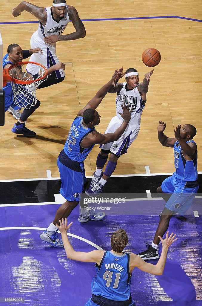 Isaiah Thomas #22 of the Sacramento Kings passes against Elton Brand #42 of the Dallas Mavericks on January 10, 2013 at Sleep Train Arena in Sacramento, California.