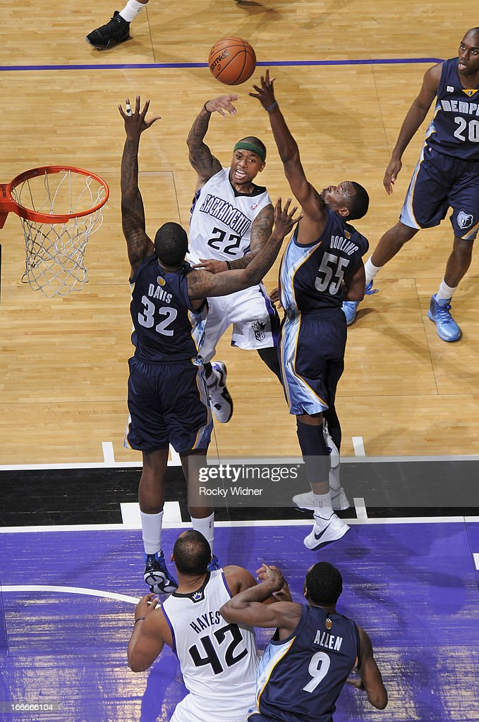 Isaiah Thomas #22 of the Sacramento Kings passes against Keyon Dooling #55 of the Memphis Grizzlies on April 7, 2013 at Sleep Train Arena in Sacramento, California.