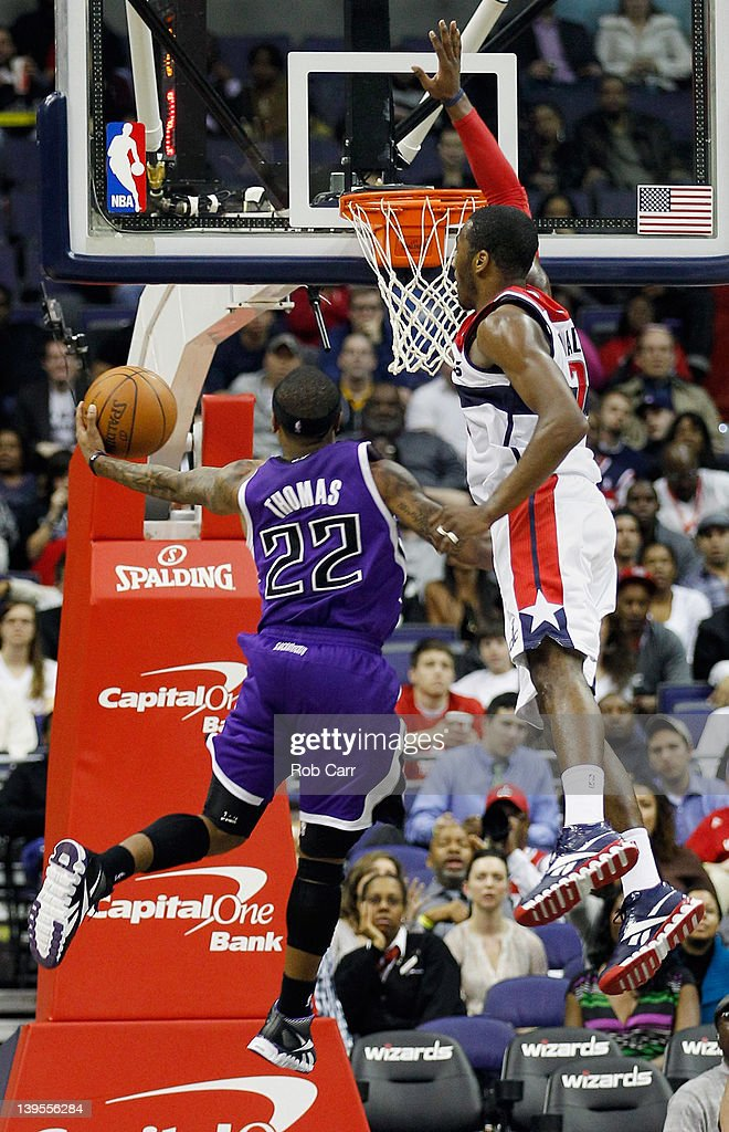 Isaiah Thomas #22 of the Sacramento Kings puts up a shot in front of <a gi-track='captionPersonalityLinkClicked' href=/galleries/search?phrase=John+Wall&family=editorial&specificpeople=2265812 ng-click='$event.stopPropagation()'>John Wall</a> #2 of the Washington Wizards during the second half at Verizon Center on February 22, 2012 in Washington, DC.