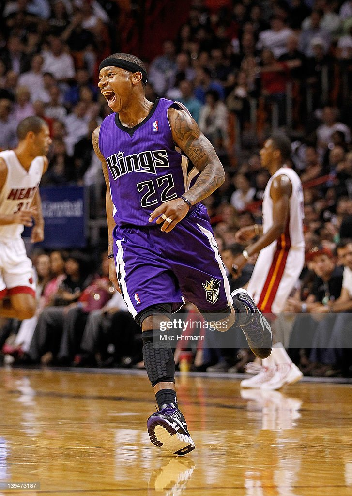 Isaiah Thomas #22 of the Sacramento Kings reacts to a three-pointer during a game against the Miami Heat at American Airlines Arena on February 21, 2012 in Miami, Florida.