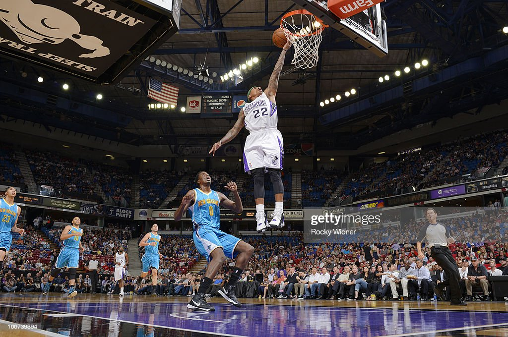 Isaiah Thomas #22 of the Sacramento Kings shoots a layup against Al-Farouq Aminu #0 of the New Orleans Hornets on April 10, 2013 at Sleep Train Arena in Sacramento, California.