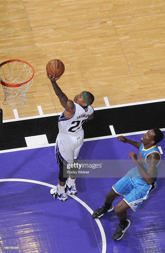 Isaiah Thomas #22 of the Sacramento Kings shoots a layup against <a gi-track='captionPersonalityLinkClicked' href=/galleries/search?phrase=Al-Farouq+Aminu&family=editorial&specificpeople=5042446 ng-click='$event.stopPropagation()'>Al-Farouq Aminu</a> #0 of the New Orleans Hornets on April 10, 2013 at Sleep Train Arena in Sacramento, California.