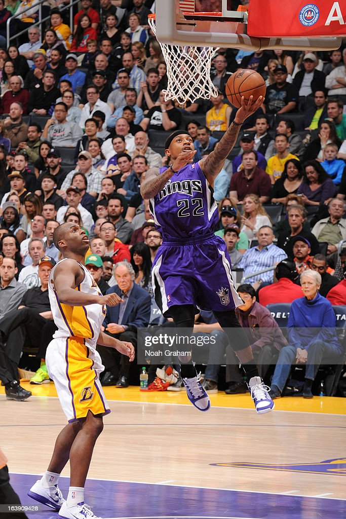 Isaiah Thomas #22 of the Sacramento Kings shoots a layup against <a gi-track='captionPersonalityLinkClicked' href=/galleries/search?phrase=Jodie+Meeks&family=editorial&specificpeople=4001727 ng-click='$event.stopPropagation()'>Jodie Meeks</a> #20 of the Los Angeles Lakers at Staples Center on March 17, 2013 in Los Angeles, California.